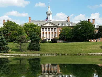 The Kehoe center, as seen from the opposite side of a pond