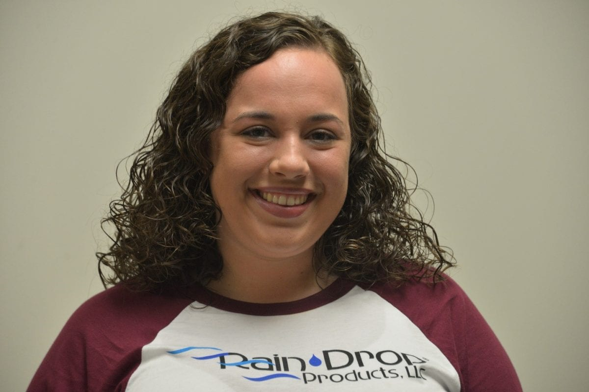 Jaylin Beebe poses with her Rain Drop Products, LLC shirt where she recently got a full time position.