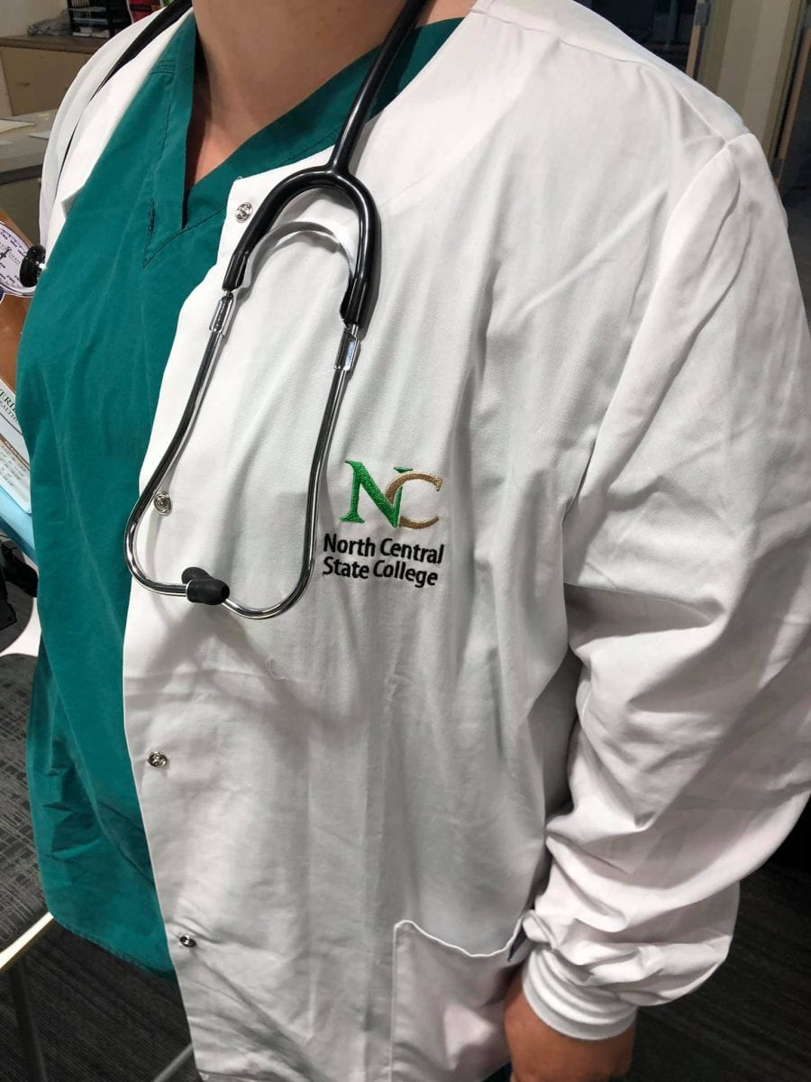 lab coat with nc state logo and stethoscope
